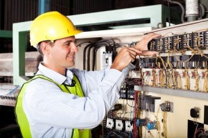 electrician working on control panel
